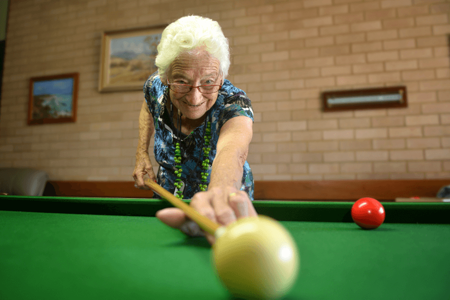 Betty playing billards